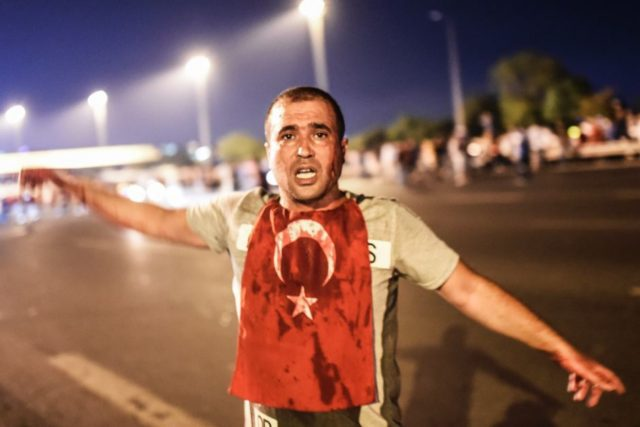 a man covered in blood fighting for his country against the coup attempt